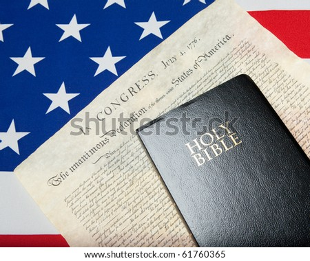 black bible with declaration of independence and ensign of the USA - stock photo