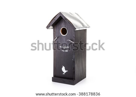 Black bird house with funny text - stock photo