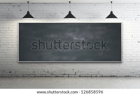 Black blackboard in brick loft - stock photo