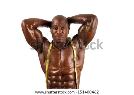 Black bodybuilder topless with centimeter showing his muscles. Strong man with perfect abs, shoulders,biceps, triceps and chest. Isolated on white background