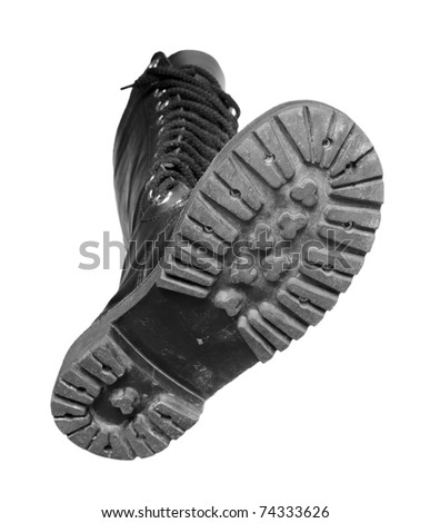 Black boot on a white background. - stock photo