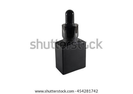 Black bottle and drip dropper aromatherapy, Water essence in bottle and drip dropper, Beauty pharmacy serum. - stock photo