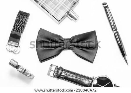 Black bow tie and men's accessories - stock photo