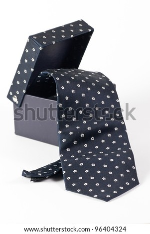 black box from which hangs a tie white background, isolated - stock photo