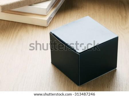 Black Box on the wooden floor.Blank Blank box mock up. - stock photo