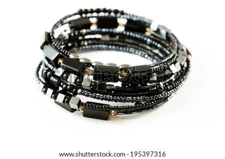Black bracelets isolated over white background. - stock photo