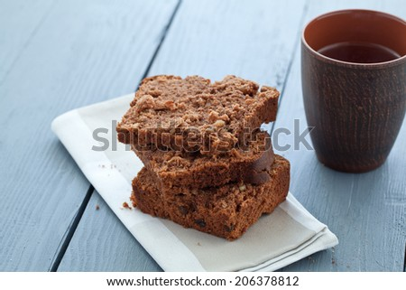 black bread on a plate and mug - stock photo