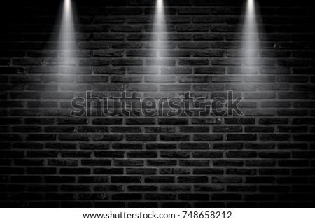 Black Brick Wall Of Dark Stone Texture With Light Fire Spotlight