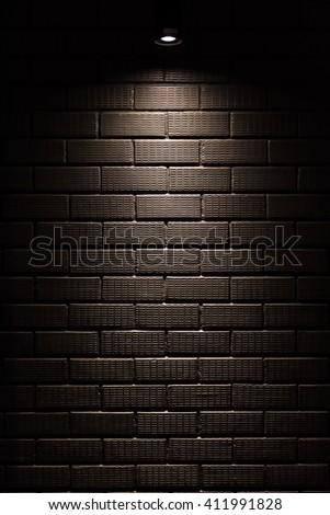 Black Brick Wall With Spotlight