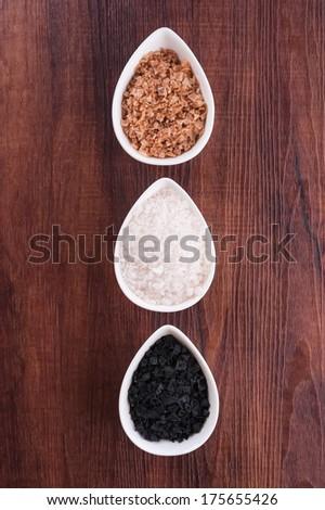 Black, brown smoked and white sea salt - stock photo
