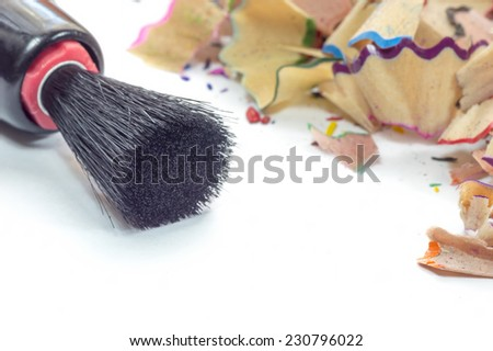 Black brush and color pencil shave macro - stock photo