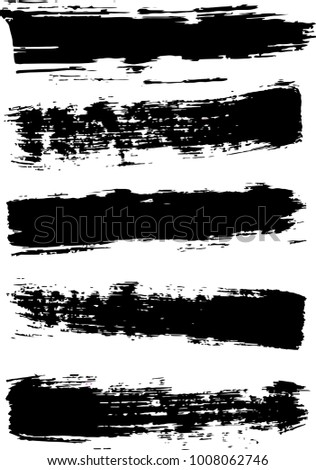 Black brush strokes with a dry brush. Set of grunge brush strokes.