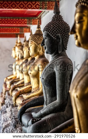 Black Buddha Image of Wat Pho, Bangkok, Thailand : In Thailand Buddha image are public domain, no artist name or any copy right appear on the image - stock photo