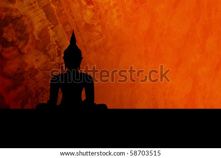 Black buddha silhouette, isolated against colorful background (incl. clipping path) - stock photo
