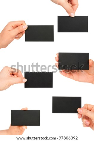 black business card in woman hand collection - stock photo