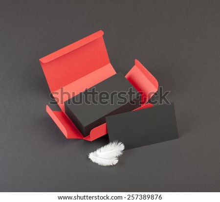 Black business cards in the red box - stock photo