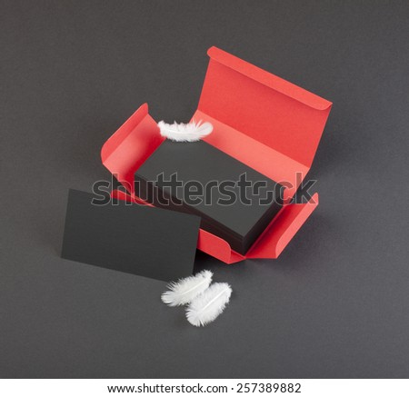 Black business cards in the red box. - stock photo