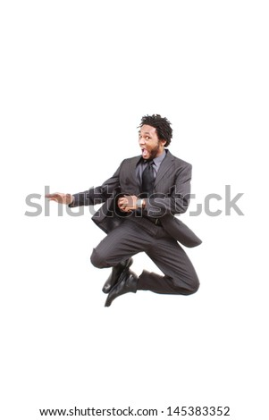 Black business man jumps with joy - stock photo