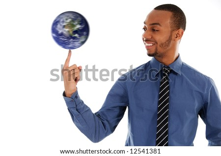 black business man spinning the earth on finger - stock photo