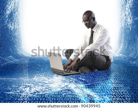 black businessman at worl with laptop - stock photo