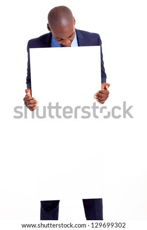 black businessman holding empty banner and looking down - stock photo