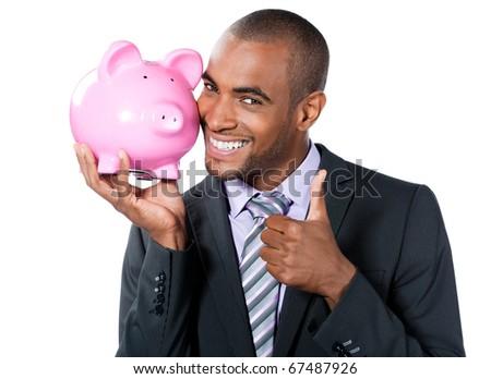 black businessman with piggy bank - stock photo