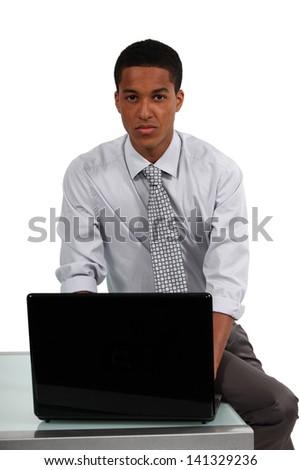 black businessman working on laptop - stock photo