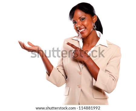 Black businesswoman looking at you pointing right on isolated background - stock photo