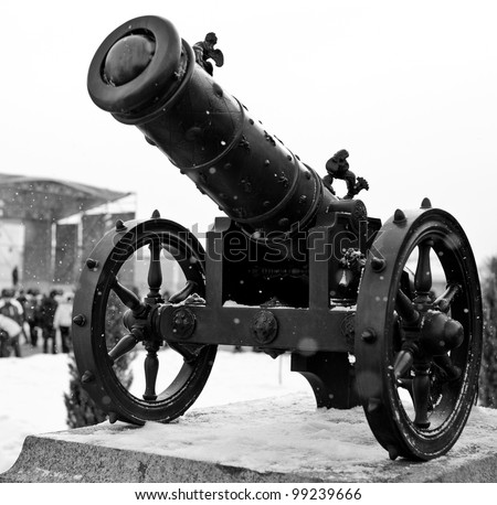 black canon history weapon on wheels - stock photo