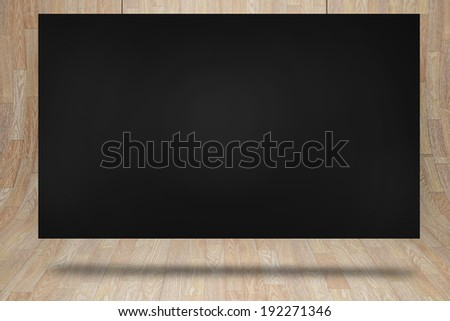 Black card against curved wooden room