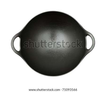 black cast iron oiled wok shot from the top, isolated on white background