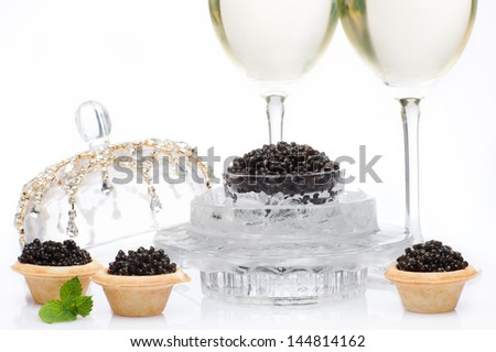 Black caviar and champagne in wine glasses on a white isolated