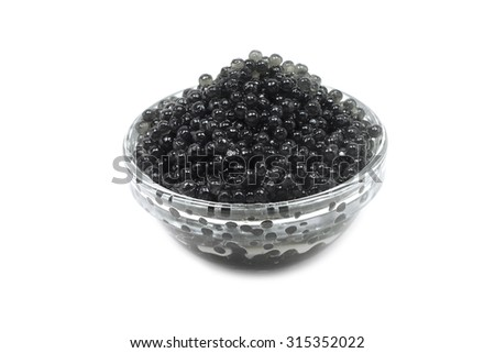 Black caviar in a glass cup on a white background