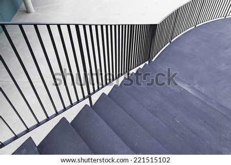 Black cement staircase, detail of a staircase on the outside of a house - stock photo