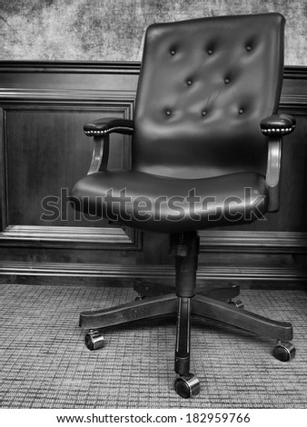 Black chair in business office with textured wall