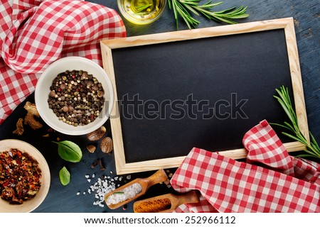 Black chalk board and spices. Template for recipes or food menu - stock photo