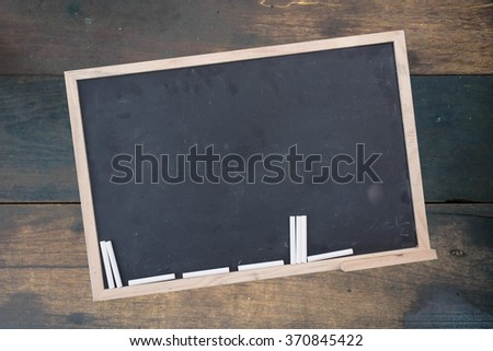 black chalk board on wood. top view education.free space for promote.