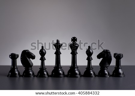 Black chess in a row on background - Business strategy and competition concept  - stock photo