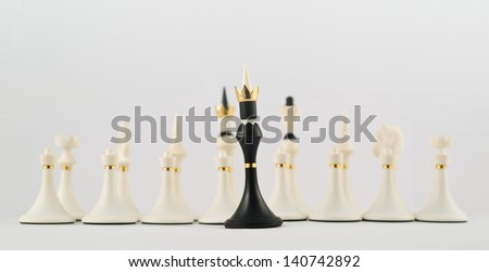 Black chess king figure opposite to the white ones composition - stock photo