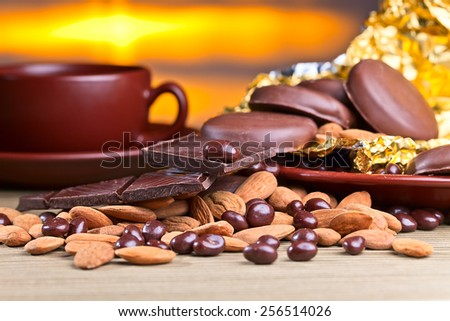 black chocolate and nuts on wooden table