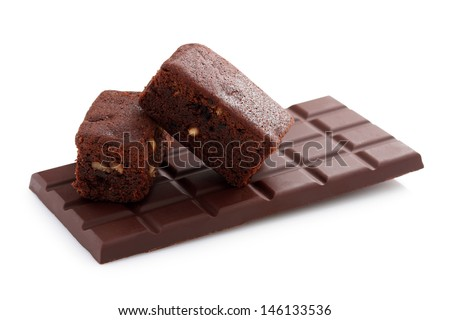 Black chocolate bar and brownie portions with hazelnuts - Isolated on white