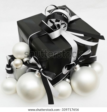 Black christmas gift with white baubles, vintage style - stock photo