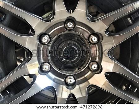 closeup steel alloy car discs black chrome wheel
