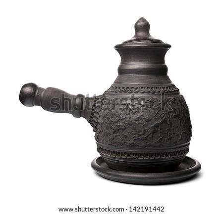 Black clay pot on a white background. - stock photo