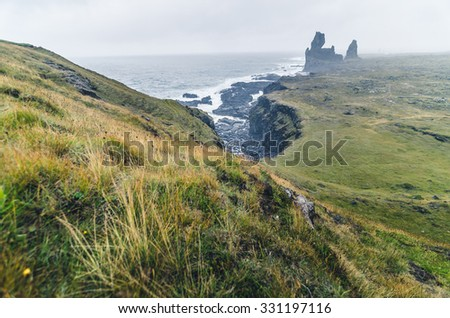 black cliffs and strange shapes in Iceland - stock photo