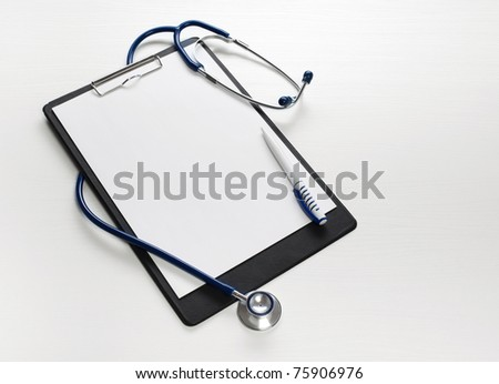 Black clipboard with  stethoscope. Medicine concept. - stock photo