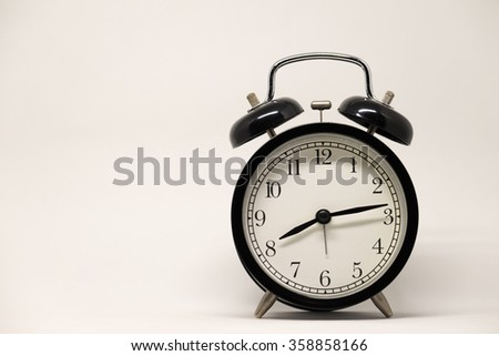 Black Clock and White Background.