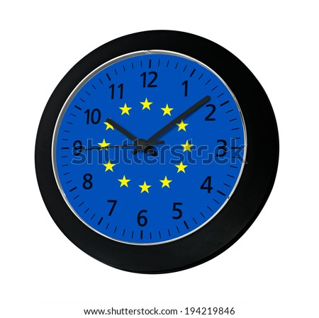 Black clock with flag of Europe on wall reads ten past ten isolated on white background - stock photo