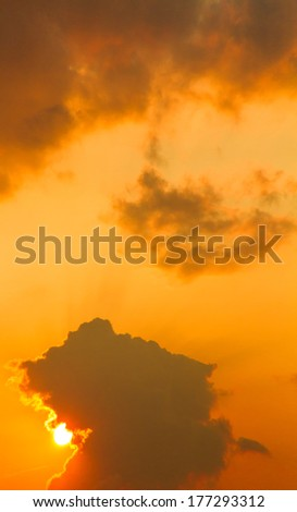 Black cloud and golden sky before sunset