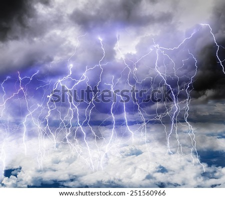 Black clouds in the sky full of lightning in a thunderstorm with a roll of Thunder - stock photo